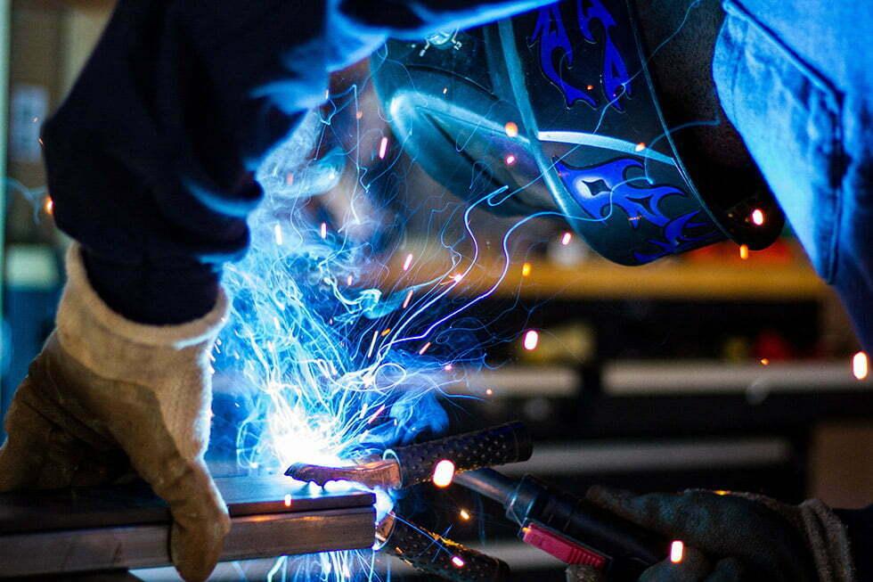 Welder wearing a welding mask